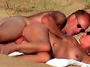 Hot blonde milf caught fucking on the beach by a peeper