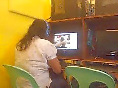 filipina lady in net cafe caught watching a guy masturbate