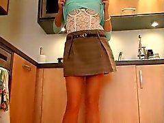 British slut Sandie Caine fingers herself in the kitchen