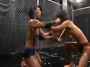 A wild naked wrestling match between two Asian chicks leads