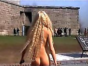 Daryl Hannah nude walking across some grass with her bare