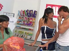 Horny Kit and Kat love sucking guy&039s pole in a shop