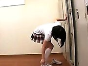 Provoking Asian schoolgirl sensually reveals the contours o