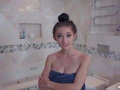 Brunette Cyrstal Rae blowing in the bathroom