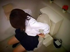 Voluptuous Asian babe sits on the toilet and pleases her ac