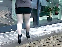 Shiny pantyhose at the cardealer