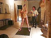 slave Gemma hanging on the ceiling and flogged