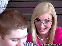 Blonde cougar munches on a teens chubby
