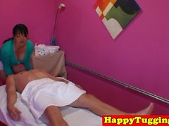 Busty asian masseuse tugs for an extra tip