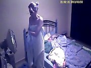 Hidden cam catches this couple getting it on in bed with blonde babe