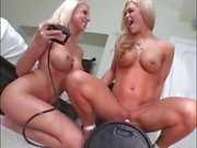 Two busty blondes takes turns riding the Sybian fuck machine