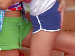 Lesbian kitties Ivana and Natasha strip outdoors