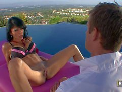 Leggy slim brunette MILF takes takes dick by the pool