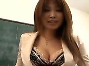 Ai Kurosawa fondles her tits and rubs pussy in front of