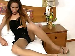 Long haired ladyboy in black lingerie sucks massive dick