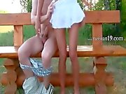 Russian teenie couple fucking on a bench