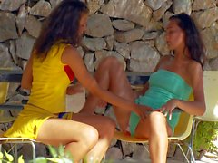 Young brunettes Maria and Monica strip outdoors