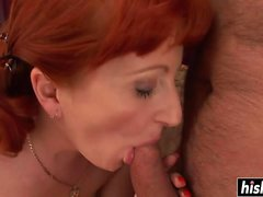 Redhead sweetie plays with a big dick