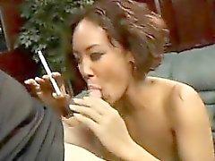 Tattooed Asian Smokes And Sucks Cock
