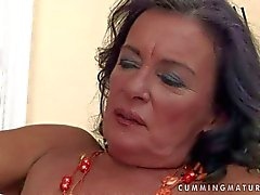 Turned on granny stuff her cunt with gigantic dildo