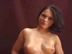 Pretty Oiled Up Girl Gives Blowjob