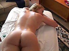 Massuer is having fun giving sweetheart a sensual massage
