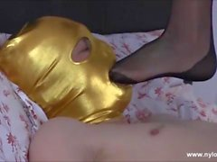 Masked gimp masturbates over hot Milfs sexy nylon stockings and licks them clean