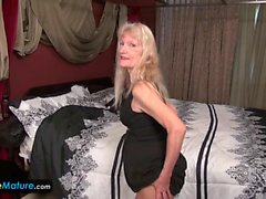 Mature woman doing a striptease in the bedroom