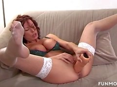 Redhead German Mom rides huge dildos