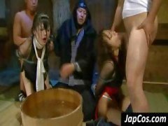 Two Asian babes are tied up slaves and get their pussy tortured