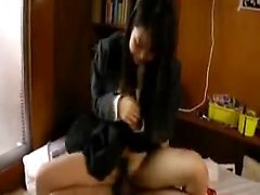 Slutty Asian girl has a dildo and a hard dick making her pe