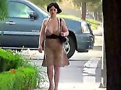 Big tits exposed on busy street