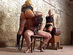 slave subjected to cruel hand job by 2 mistreses