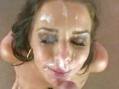 Veronica Avluv gets her face sprayed with warm jizz