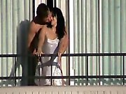 Cute milf caught getting fucked on a hotel balcony