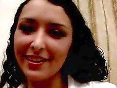 Beautiful brunette Russian seductress Julie sucking an