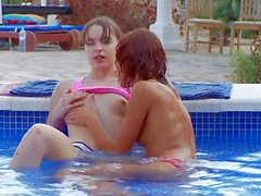 Teenage lesbians Ivana and Natasha in the pool