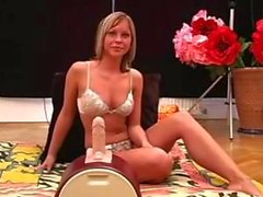 Hot Blonde Girl Rides The Sybian While Giving Handjob