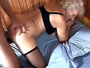 Slutty mature woman in black stockings gets banged deep by a young man