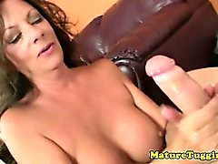 Brunette mature milf tugging hard cock