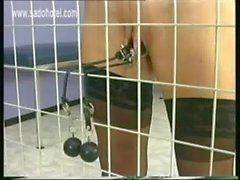 Naughty girl in a jail got her big metal clamps with heavy weight on her tight pussy