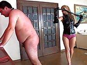 Blonde mistress whips her slave