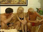 Hot blonde gets guys cock and sucks it hard on the sofa