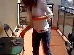 Girl strips on balcony