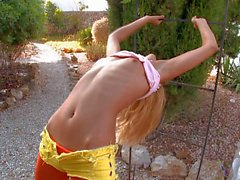 Playful blonde Sasha flashes her pussy outdoors