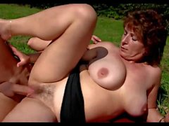 Busty Cougar And Her Toyboy Outdoor