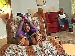 We find Kapri Styles bound with her feet behind her head