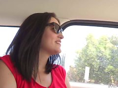 MILF brunette flashes her bush in the car