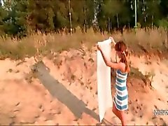 czech babe shows pink on the hot sand