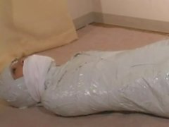 Japanese woman mummified and cleave gagged